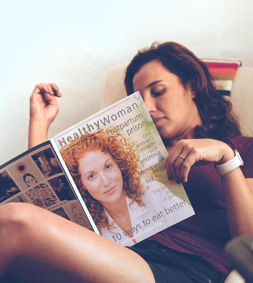 Young adult reading magazine